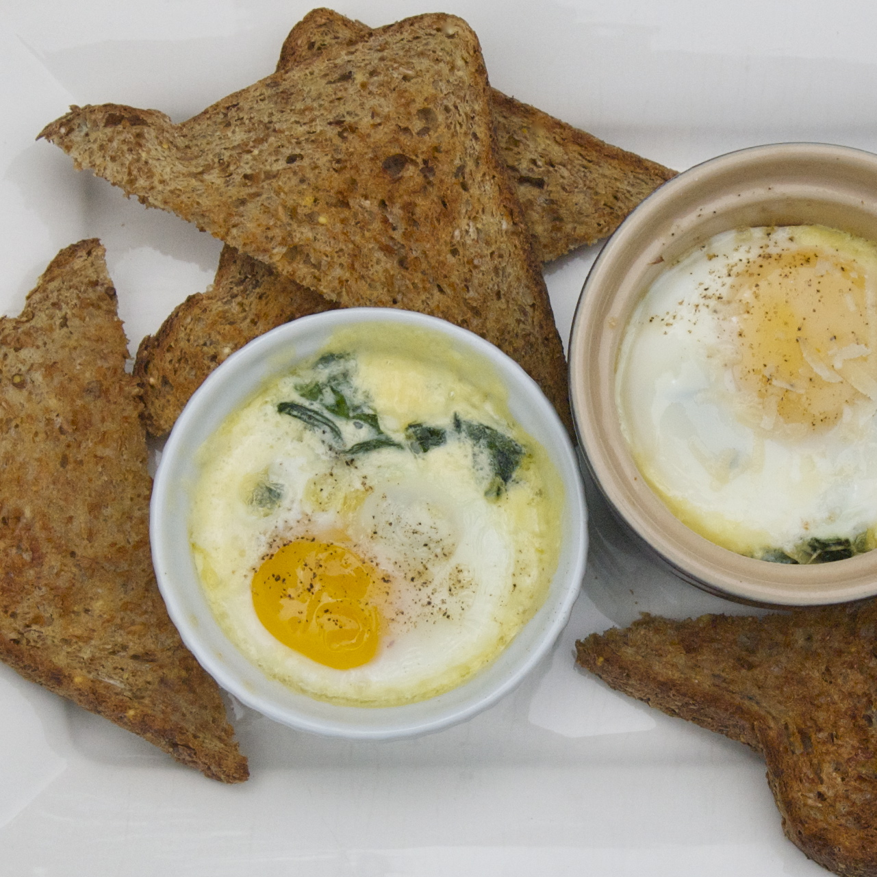Ramekin-Baked Eggs with Spinach and Cream